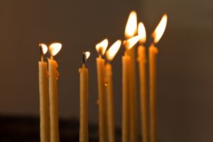 thin-candles-in-church